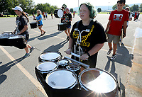 NWA Democrat-Gazette/DAVID GOTTSCHALK Makenna Doss, a junior plays the tenner drums with the Farmington High School Marching Band, during a drill Monday, August 5, 2019, during practice at the school in Farmington. The 76 member marching band is preparing for their first performance during the home opening football game against Prairie Grove High School.