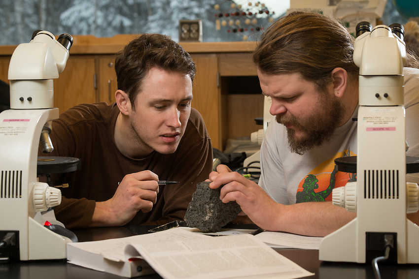 Adam Jackson, right, and Matthew Tucker, left, interpret rock samples during a lab exercise for Geology Professor Erin Shea's Igneous and Metamorphic Petrology class (GEOL A322) in UAA's ConocoPhillips Integrated Science Building. Students in GEOL A322 learn to identify and classify igneous and metamorphic rocks; interpret different rock textures, structures, and mineralogy; and learn about the chemical and physical principles that control the formation of rocks.
