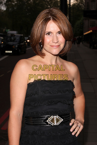 HARRIET SCOTT .At the Sony Radio Academy Awards, Grosvenor House Hotel, Park Lane, London, England, UK, May 10th 2010..half length black dress strapless hand on hip belt ruffles waist.CAP/AH.©Adam Houghton/Capital Pictures.