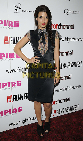 Tonia Sotiropoulou.'Berberian Sound Studio' film premiere Film4 FrightFest Day 4, Empire cinema, Leicester Square, London, England. 26th August 2012.full length black lace silk satin dress open toe ankle boots hand on hip.CAP/CAN.©Can Nguyen/Capital Pictures.