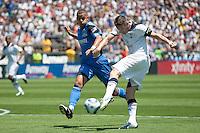 Robbie Keane (right) kicks the ball against Jason Hernandez (left). San Jose Earthquakes vs Tottenham Hotspur at Buck Shaw Stadium in Santa Clara, California on July 17th, 2010.