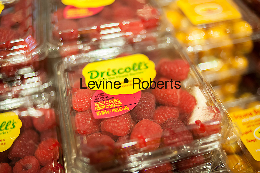 Driscoll's brand Mexico grown raspberries in the new Whole Foods Market opposite Bryant Park in New York on opening day Saturday, January 28, 2017. The store in Midtown Manhattan is the chain's 11th store to open in the city. The store has a large selection of prepared foods from a diverse group of vendors inside the store.  (© Richard B. Levine)