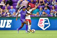 Orlando, FL - Saturday July 07, 2018: Chioma Ubagagu, Taylor Smith during the first half of a regular season National Women's Soccer League (NWSL) match between the Orlando Pride and the Washington Spirit at Orlando City Stadium.