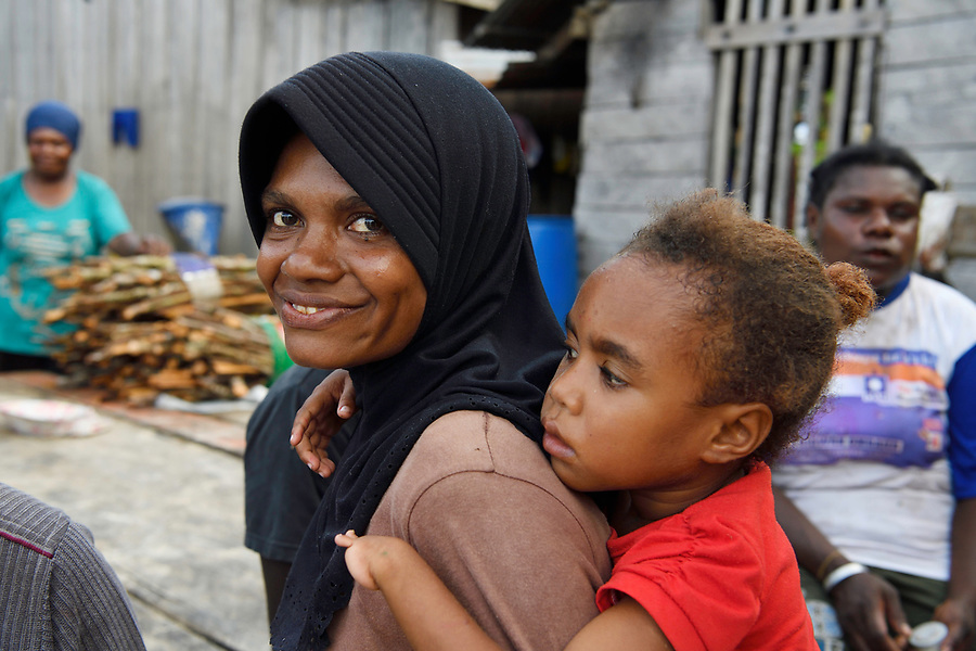 """Aina with her daughter Sansia, from the village Uristinom, Aiduma Island, Triton Bay, near mainland New Guinea, Western Papua, Indonesian controlled New Guinea, on the Science et Images """"Expedition Papua, in the footsteps of Wallace"""", by Iris Foundation"""