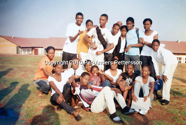 GA-MASEHLONG, SOUTH AFRICA - AUGUST 7: A undated high school photo of Caster Semenya (in blue T-shirt) and her friends on August 7,  in GA-MASEHLONG, South Africa.Caster Semenya won the 800 meters world championship gold medal in Berlin in 2009 was recently cleared to run after her career was held back due to gender testing. She grew up in this rural village in Limpopo, northern South Africa, and she started running only a few years ago, and quickly appeared from nowhere to the world stage. After being banned for almost a year she was cleared by the IAAF and cleared to compete in July 2010. (Photo by Per-Anders Pettersson/Getty Images)