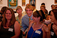 While his mother Elizabeth smiles, John rises to accept his $5,000 scholorship to the Ringling College of Art and Design, in the Naples Art Associations 40th Annual Jade N. Riedel Scholarship Competition at The von Liebig Art Center, Naples, Florida, April 15, 2011. Photo by Debi PIttman Wilkey