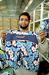 One worker showing the new Hawaian bath shirt produced for H&M in  Banga Garment, Dhaka