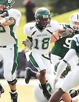DeAnthony White of Eastern Michigan runs through the Ohio Defense on Saturday 13th, 2007. Ohio won their Homecoming game 48 42..Eastern Michigan Football vs. Ohio University, 10132007