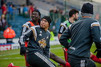 BLACKBURN, ENGLAND - JANUARY 24:  ( L-R ) Bafetibis Gomis of Swansea City and Jefferson Montero of Swansea City look at a big screen while warming up  during the FA Cup Fourth Round match between Blackburn Rovers and Swansea City at Ewood park on January 24, 2015 in Blackburn, England.  (Photo by Athena Pictures/Getty Images)