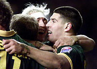 Picture by Shaun Flannery\SWpix.com - 25/11/00 - Rugby League World Cup Final 2000 - Australia v New Zealand, Old Trafford, Manchester, England - Australia's Trent Barrett celebrates with team mates after scoring.