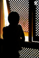Silhouette of woman looking outside from Moucharabieh window (Licence this image exclusively with Getty: http://www.gettyimages.com/detail/sb10065474db-001 )