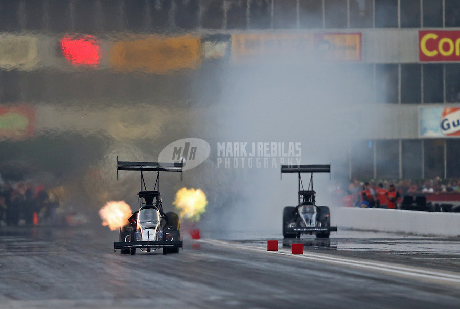 Apr. 26, 2013; Baytown, TX, USA: NHRA top fuel dragster driver Larry Dixon (left) races alongside J.R. Todd during qualifying for the Spring Nationals at Royal Purple Raceway. Mandatory Credit: Mark J. Rebilas-