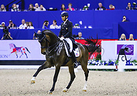 OMAHA, NEBRASKA - APR 1: Steffen Peters rides Rosamunde during the FEI World Cup Dressage Final II at the CenturyLink Center on April 1, 2017 in Omaha, Nebraska. (Photo by Taylor Pence/Eclipse Sportswire/Getty Images)