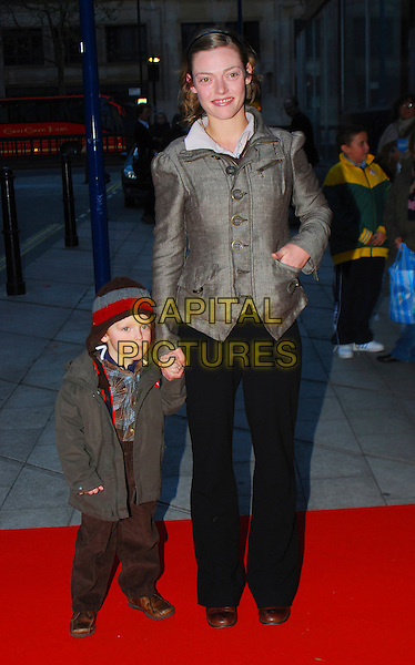 "CAMILLA RUTHERFORD & SON.At ""The Snowman"" Press Night, .Peacock Theatre, London, England, .December 9th 2006..full length child kid.CAP/CAN.©Can Nguyen/Capital Pictures"