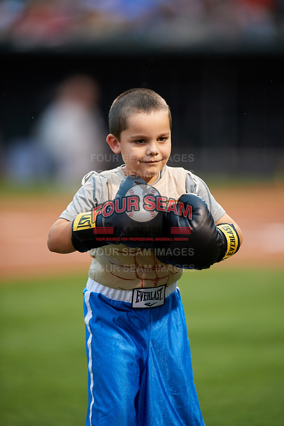 A young fan takes part in a promotional event during an Oklahoma City Dodgers game against the Colorado Springs Sky Sox on June 2, 2017 at Chickasaw Bricktown Ballpark in Oklahoma City, Oklahoma.  Colorado Springs defeated Oklahoma City 1-0 in ten innings.  (Mike Janes/Four Seam Images)