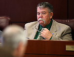 Nevada Sen. Pete Goicoechea, R-Eureka, works in a committee hearing at the Legislative Building in Carson City, Nev., on Tuesday, Feb. 3, 2015. <br /> Photo by Cathleen Allison