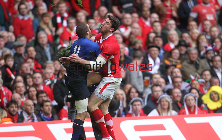 Painful collision for Alex Cuthbert as he crashes into Alexis Palisson..RBS 6 Nations 2012.Wales v France.Millennium Stadium.17.03.12..CREDIT: STEVE POPE-SPORTINGWALES