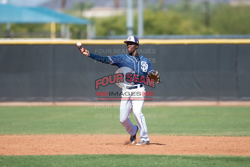 San Diego Padres second baseman Jordy Barley (15) throws to first base during an Instructional League game against the Milwaukee Brewers at Peoria Sports Complex on September 21, 2018 in Peoria, Arizona. (Zachary Lucy/Four Seam Images)