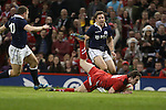 Rhodri Williams dives over to score for Wales.<br /> RBS 6 Nations 2014<br /> Wales v Scotland<br /> Millennium Stadium<br /> <br /> 15.03.14<br /> <br /> ©Steve Pope-SPORTINGWALES