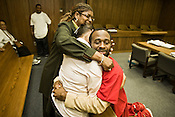 Erick Daniels hugs his mother, Karen Daniel, and Aunt Denise Spivey, after Durham Superior Court Judge Orlando Hudson dismissed charges against him, Friday, Sept. 19, 2008. Daniels had served seven years.