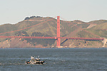 A San Francisco Police Department boat patrols San Francisco Bay near the Golden Gate Bridge in San Francisco, California.