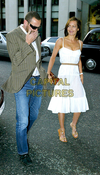 TARA PALMER TOMKINSON.At the Glamour Women of the Year Awards, .Berkeley Square, London, June 7th 2005..full length white pleated dress summery brown beige belt ribbon .Ref: JL.www.capitalpictures.com.sales@capitalpictures.com.©Jonathan Larkin/Capital Pictures.