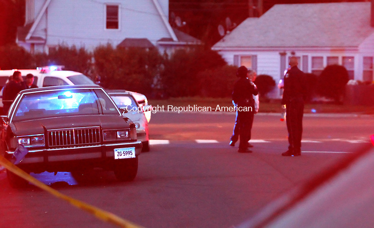 Waterbury, CT- 11, October 2010-101110CM03  Police secure the scene upon arrival of Forensics at the corner of Cooke St. and      Leffingwell Ave in Watebrury Monday evening. A motor vehicle collided with a man on a dirt-bike, sending the rider to the hospital.  Christopher Massa Republican-American