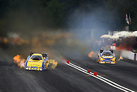 Aug. 3, 2013; Kent, WA, USA: NHRA funny car driver Matt Hagan (left) alongside teammate Ron Capps during qualifying for the Northwest Nationals at Pacific Raceways. Mandatory Credit: Mark J. Rebilas-USA TODAY Sports