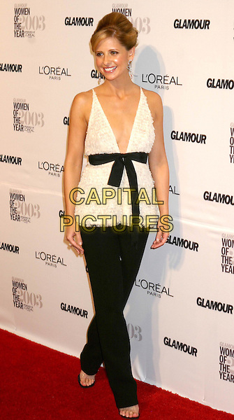 SARAH MICHELLE GELLAR.14th Annual Glamour Women Of The Year Awards at the American Museum of Natural History.full length, full-length, black trousers, white vest top, bow-tie, ribbon, plunging neckline, cleavage.www.capitalpictures.com.sales@capitalpictures.com.©Capital Pictures.