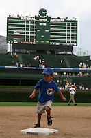 August 9, 2009:  Iowa Cubs fans run the bases after a game at Wrigley Field in Chicago, IL.  Iowa is the Pacific Coast League Triple-A affiliate of the Chicago Cubs.  Photo By Mike Janes/Four Seam Images