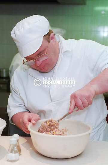 Man with Downs Syndrome Cooking,