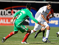 05 July 2009:  David Martinez of Nicaragua dribbles the ball away from Ismael Rodriguez of Mexico during the game at Oakland-Alameda County Coliseum in Oakland, California.    Mexico defeated Nicaragua, 2-0.
