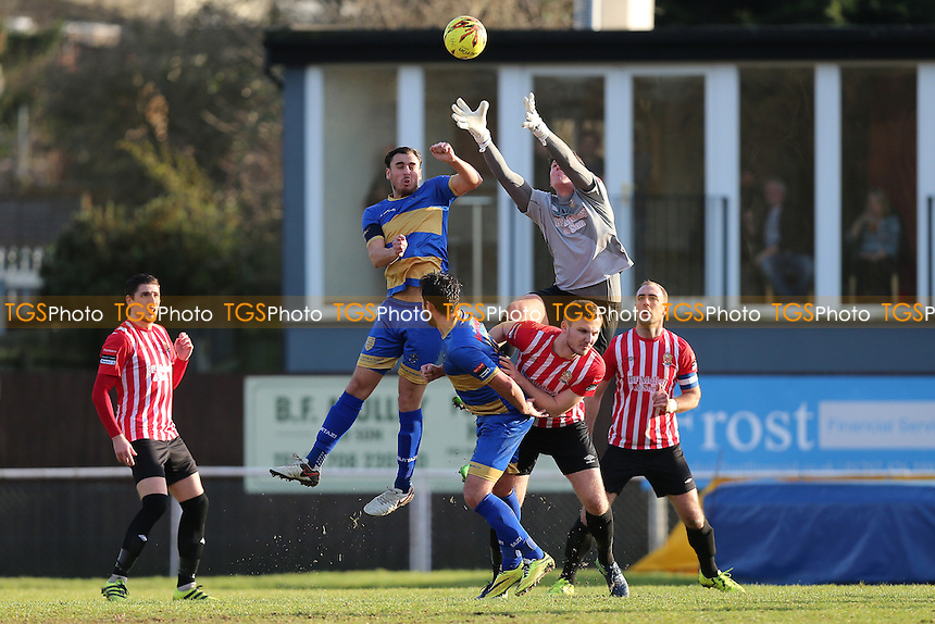 Sam Mott of Hornchurch denies James Ishmail of Romford during AFC Hornchurch vs Romford, Ryman League Division 1 North Football at Hornchurch Stadium on 4th February 2017