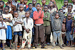 Children watching arrival of a mission plane in the Congolese village of Minga.