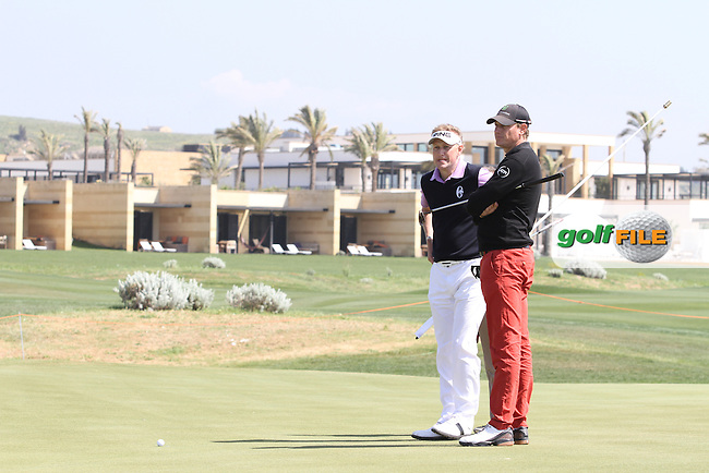 Simon Wakefield (ENG) and Maarten Lafeber (NED) wait for officials to  make a decision concerning the strong winds on the 8th green on Day 3 of the 2012 Sicilian Open at Verdura Golf and Spa Resort, Sicily, Italy...(Photo Jenny Matthews/www.golffile.ie)