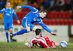 St Johnstone v Brechin....22.03.11  Scottish Cup Quarter Final replay.Murray Davidson tackled by Craig Molloy.Picture by Graeme Hart..Copyright Perthshire Picture Agency.Tel: 01738 623350  Mobile: 07990 594431