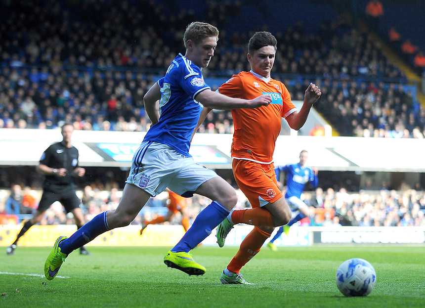 Blackpool's Henry Cameron vies for possession with Ipswich Town's Teddy Bishop<br /> <br /> Photographer Kevin Barnes/CameraSport<br /> <br /> Football - The Football League Sky Bet Championship - Ipswich Town v  Blackpool - Saturday 11th April 2015 - Portman Road - Ipswich<br /> <br /> &copy; CameraSport - 43 Linden Ave. Countesthorpe. Leicester. England. LE8 5PG - Tel: +44 (0) 116 277 4147 - admin@camerasport.com - www.camerasport.com