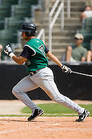 Augusta third baseman Elio Sarmiento (32) follows through on his swing versus Kannapolis at Fieldcrest Cannon Stadium in Kannapolis, NC, Monday, September 3, 2007.