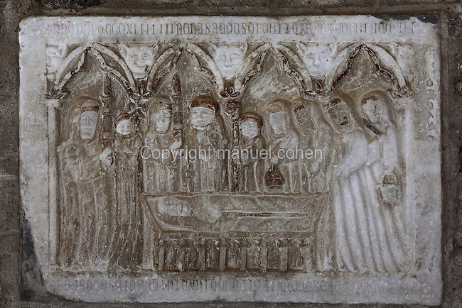 Abbot of the Abbaye Saint Martin du Canigou, 13th century Gothic style funerary relief embedded in the pillars of the cloister, Abbey church of Saint Martin du Canigou, Romanesque treasure from the early 11th century, Casteil, Pyrenees Orientales, France. Picture by Manuel Cohen