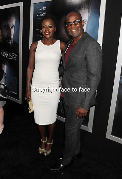 BEVERLY HILLS, CA- SEPTEMBER 12: Actress Viola Davis (L) and Julius Tennon arrive at the 'Prisoners' - Los Angeles Premiere at the Academy of Motion Picture Arts and Sciences on September 12, 2013 in Beverly Hills, California.<br />