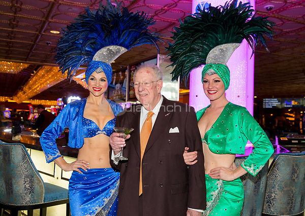 LAS VEGAS, NV - March 16, 2017: ***HOUSE COVERAGE*** Former Las Vegas Mayor and Host Committee Chairman Oscar B. Goodman and showgirls pictured arriving at Hoops Central Basketball viewing event at Westgate Las Vegas Resort & Casino in Las vegas, NV on March 16, 2017. Credit: Erik Kabik Photography/ MediaPunch