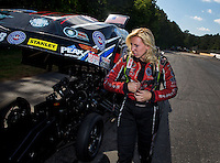 May 19, 2014; Commerce, GA, USA; NHRA funny car driver Courtney Force reacts after losing in the final round during the Southern Nationals at Atlanta Dragway. Mandatory Credit: Mark J. Rebilas-USA TODAY Sports