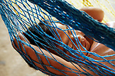 BELIZE, Punta Gorda, Toledo District, a young girl has a nap in a hammock, San Jose Maya Village