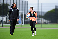 Dr. Jez McCluskey, Club Doctor speaks with Barrie McKay of Swansea City  during the Swansea City Training Session at The Fairwood Training Ground, Wales, UK. Tuesday 11th September 2018