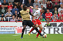 James Dunne of Stevenage is tackled by Moses Odubajo of Leyton Orient<br />  - Stevenage v Leyton Orient - Sky Bet League 1 - Lamex Stadium, Stevenage - 17th August, 2013<br />  © Kevin Coleman 2013
