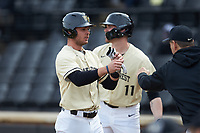 Bruce Steel (17) of the Wake Forest Demon Deacons is greeted by teammates after scoring a run against the Notre Dame Fighting Irish at David F. Couch Ballpark on March 10, 2019 in  Winston-Salem, North Carolina. The Demon Deacons defeated the Fighting Irish 7-4 in game one of a double-header.  (Brian Westerholt/Four Seam Images)