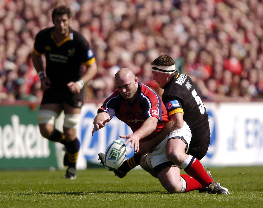 Photo. Richard Lane. .Munster v London Wasps. Heineken Cup Semi Final. 25/04/2004..John Hayes is tackled by Richard Birkett..