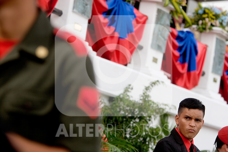 "A member of Venezuelan President Hugo Chavez security, watches a military parade in Valencia, Venezuela, on Saturday, June 24, 2006. The military parade was to celebrate Army Day and took place in ""Campo de Carabobo"", the field where the last big battle for the Venezuelan independence was won. (ALTERPHOTOS/Alvaro Hernandez)."