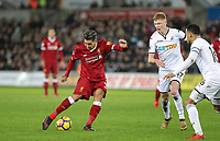 Roberto Firmino of Liverpool hits a shot at goal during the Premier League match between Swansea City and Liverpool at the Liberty Stadium, Swansea, Wales on 22 January 2018. Photo by Mark Hawkins / PRiME Media Images.