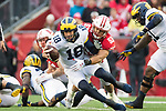 Wisconsin Badgers linebacker T.J. Edwards (53) sacks Michigan Wolverines quarterback Brandon Peters (18) during an NCAA College Big Ten Conference football game against the Michigan Wolverines Saturday, November 18, 2017, in Madison, Wis. The Badgers won 24-10. (Photo by David Stluka)